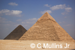 Pyramids at Giza under blue sky